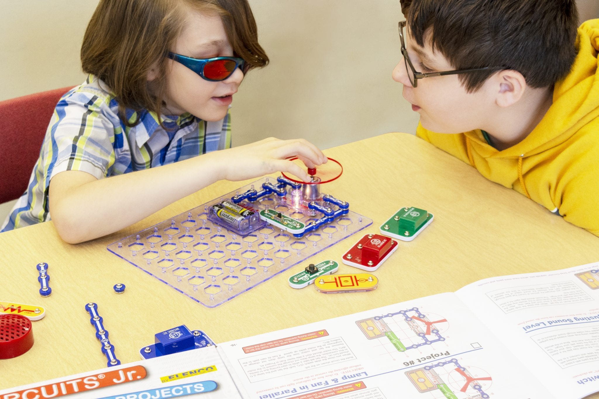 Two boys working on a circutry project using Snap Circuits Jr.