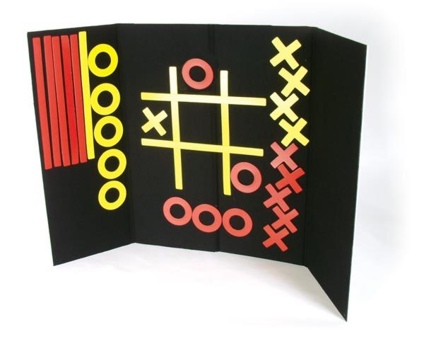 Tic-Tac-Toe accessory kit components displayed on tri-fold Invisiboard
