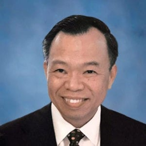 Portrait of Yung Nguyen Smiling