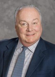 Portrait of Judge David Holton II smiling