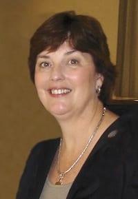 A portrait of Dr. Julie Lee smiling