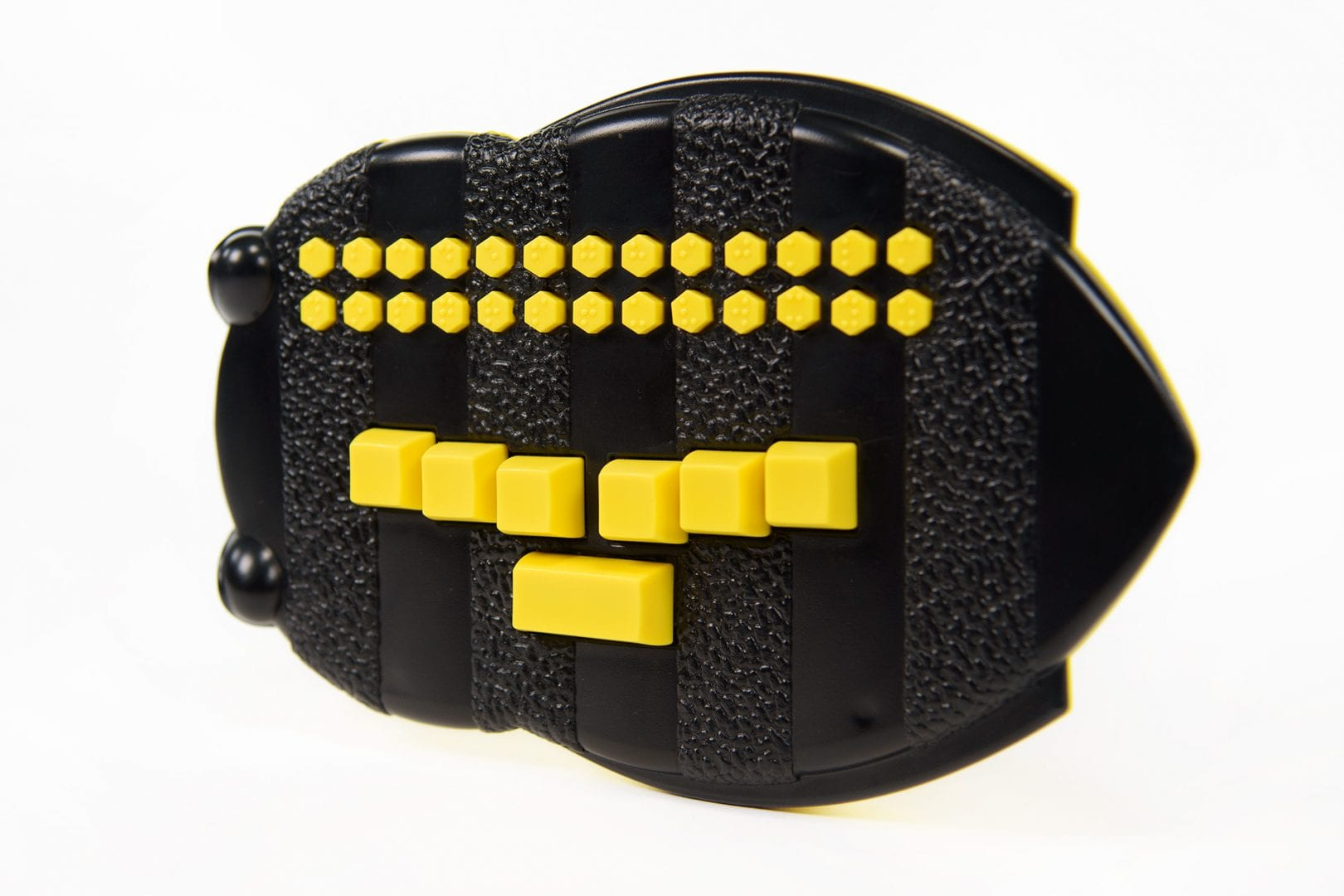 Photo of the Braille Buzz. The unit is bee-shaped black plastic with bright yellow buttons.