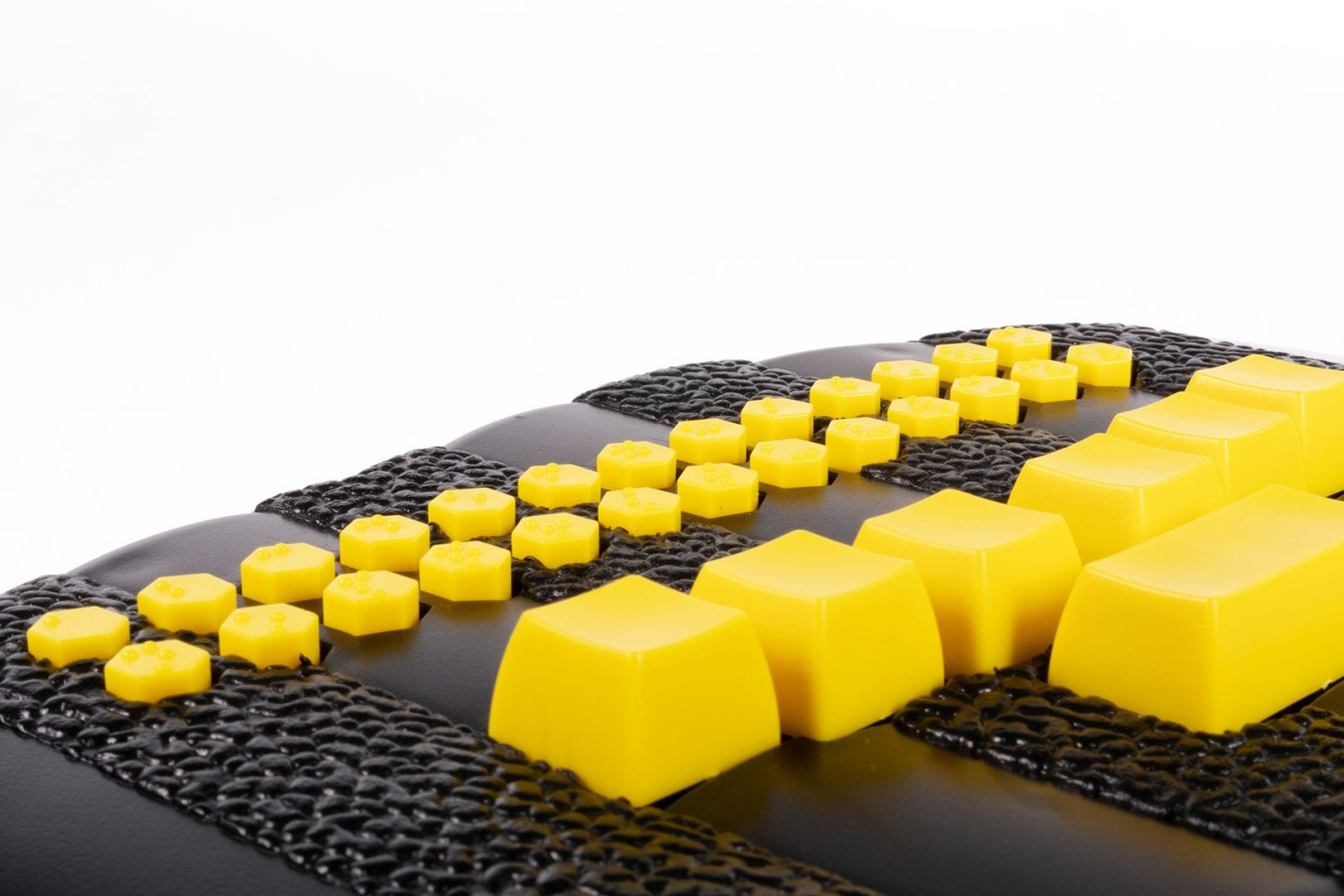 close-up photo of the Braille Buzz and its bright yellow buttons