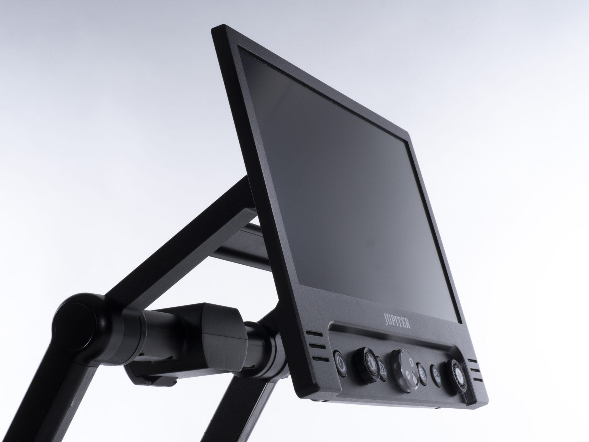 Jupiter magnifier screen, shows knobs and buttons. Product is sleek and black on a white background.