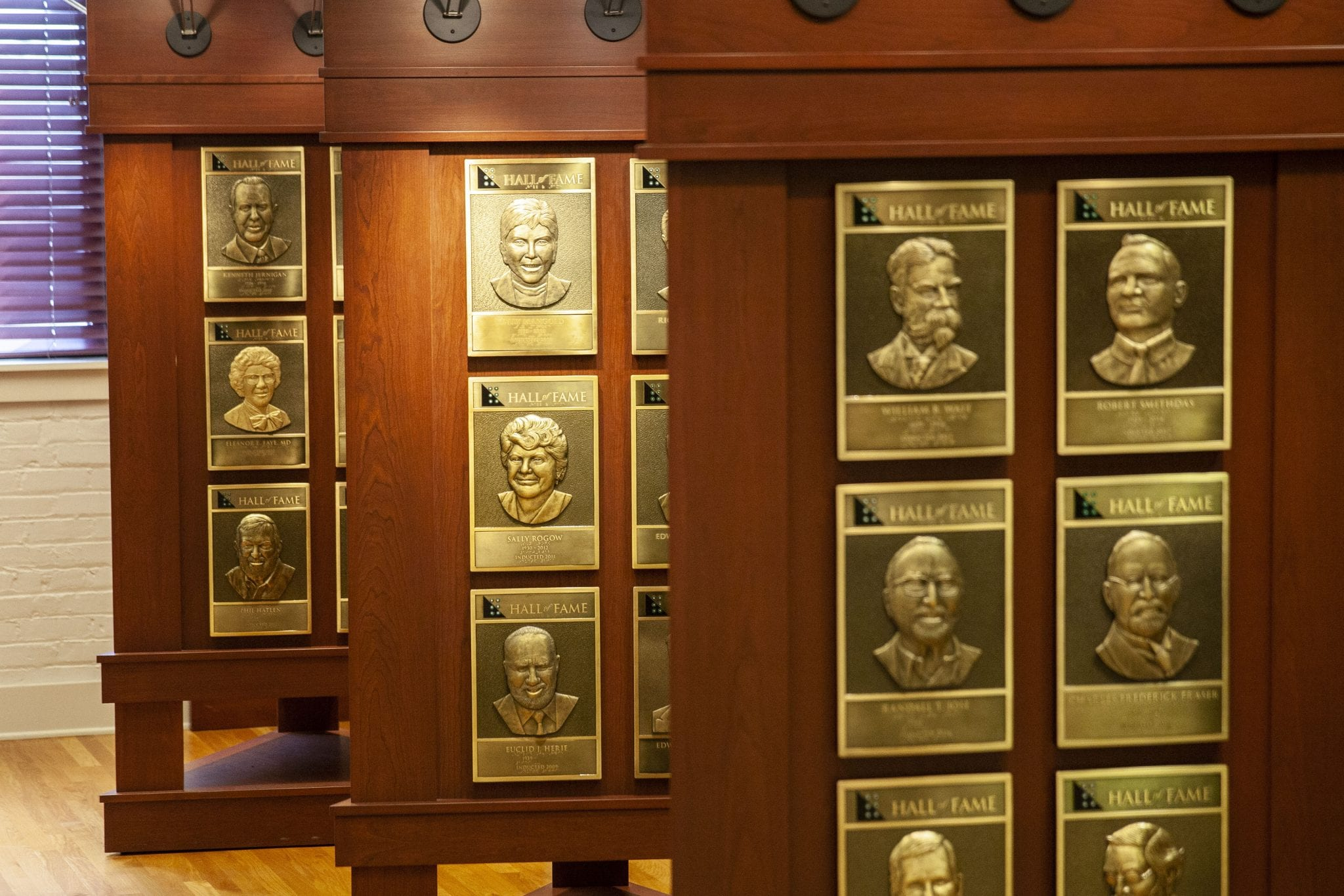 bronze plaques of Hall of Fame inductees on wooden stands