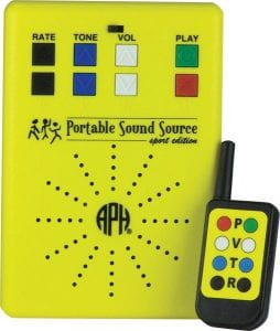 yellow sound source with black, blue, white, green, and red buttons. The black and yellow remote sits next to it with corresponding buttons.