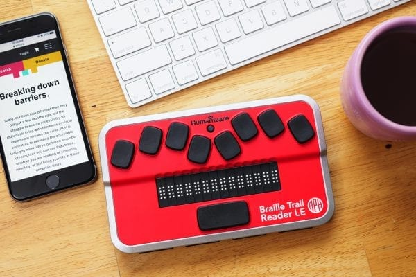 Braille Trail Reader with keyboard and coffee and smartphone