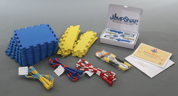pieces of the Jump Rope kit laid out including three types of jump rope and the foam pad squares