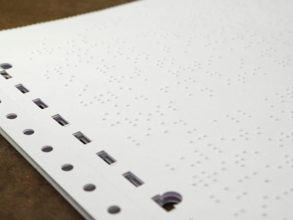 White Fanfold Tractor Feed Braille Transcribing Paper Close up