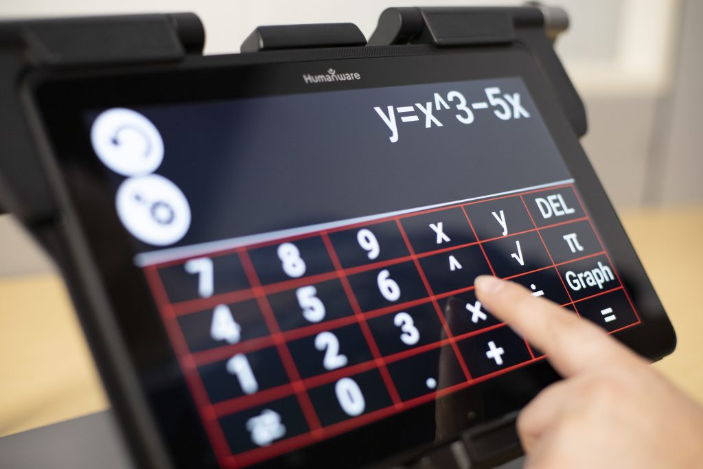 Hand touching MATT Connect screen, screen showing an equation on a scientific calculator