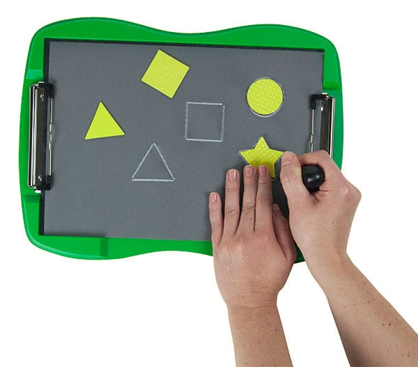 hands tracing geometric shapes on the tactile doodle with a stylus