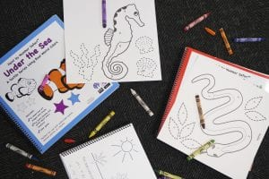 a variety of coloring pages and crayons