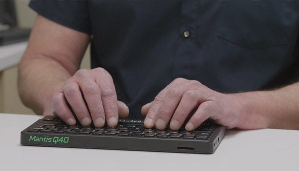 Close up of user typing on the Mantis Q40