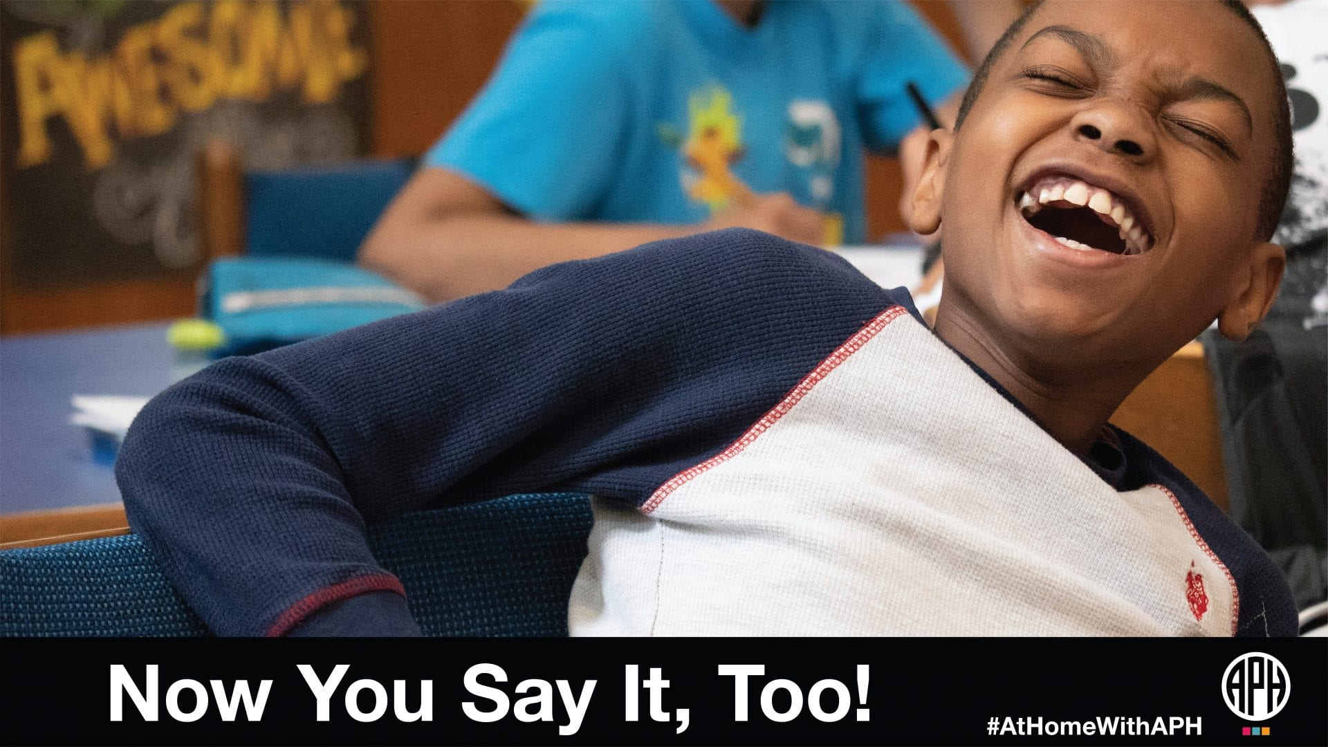 """a boy laughing. text reads """"now you say it, too! #AtHomeWithAPH"""""""