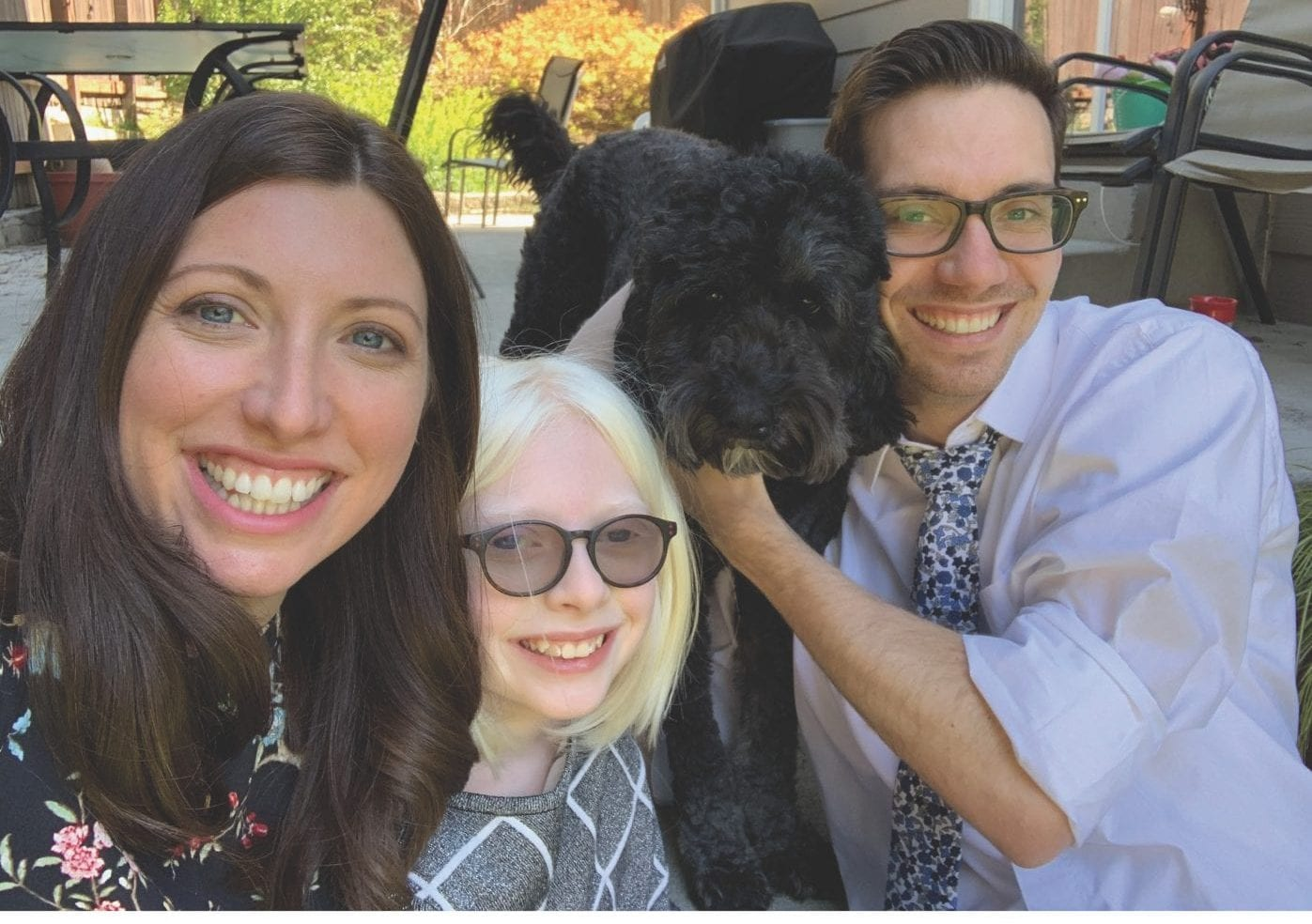a photo of Maghan, Kaitlin, Tyler, and their dog