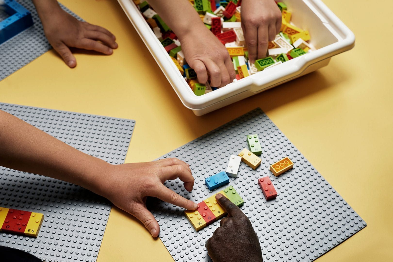 Group of children learning through play with LEGO Braille Bricks 02