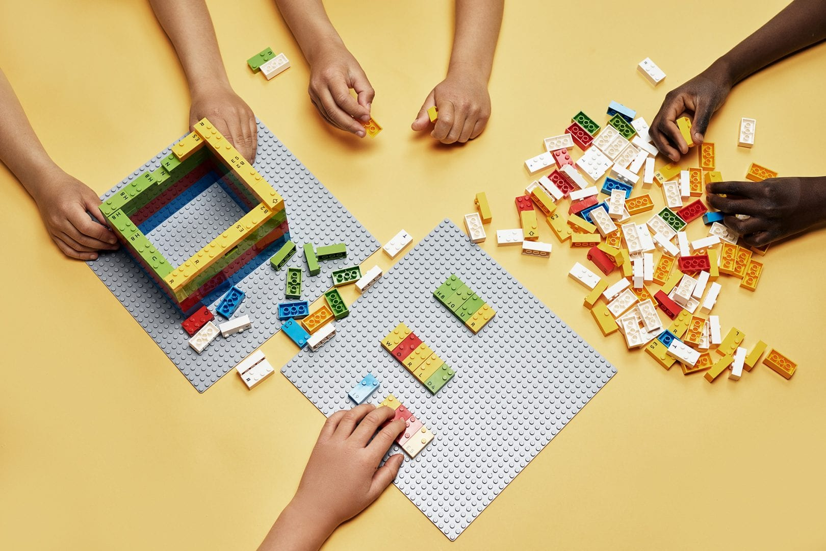 Group of children learning through play with LEGO Braille Bricks