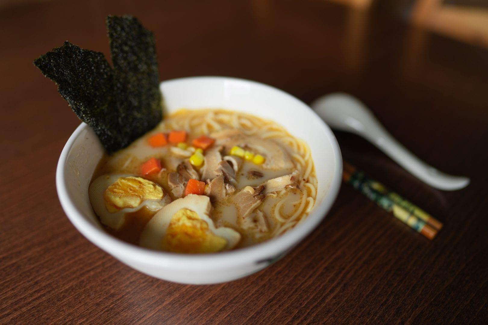 a bowl on ramen noodles on a table