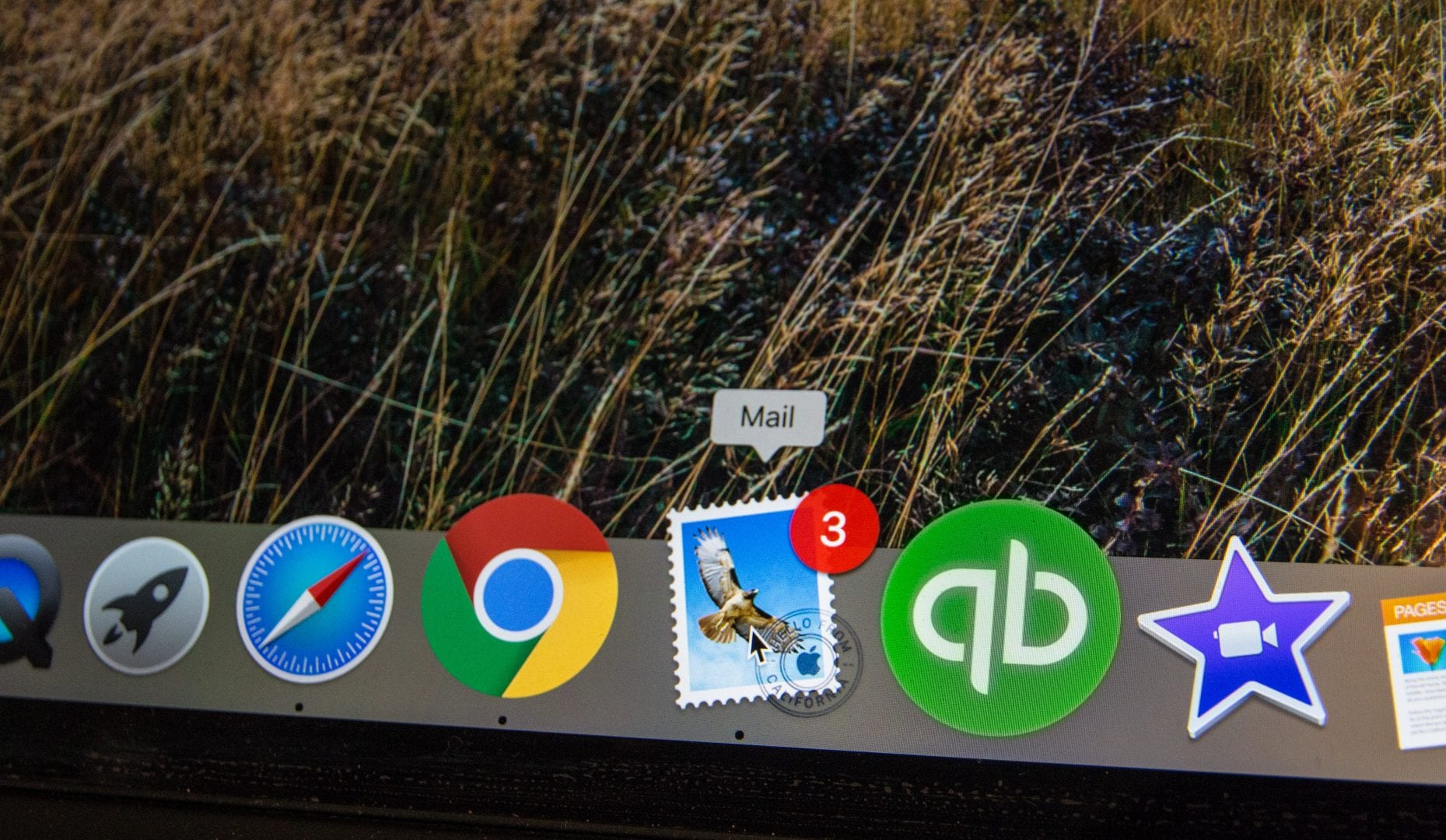 a menu bar of a computer screen showing the icons for different features including an email icon with a notification for 3 new emails
