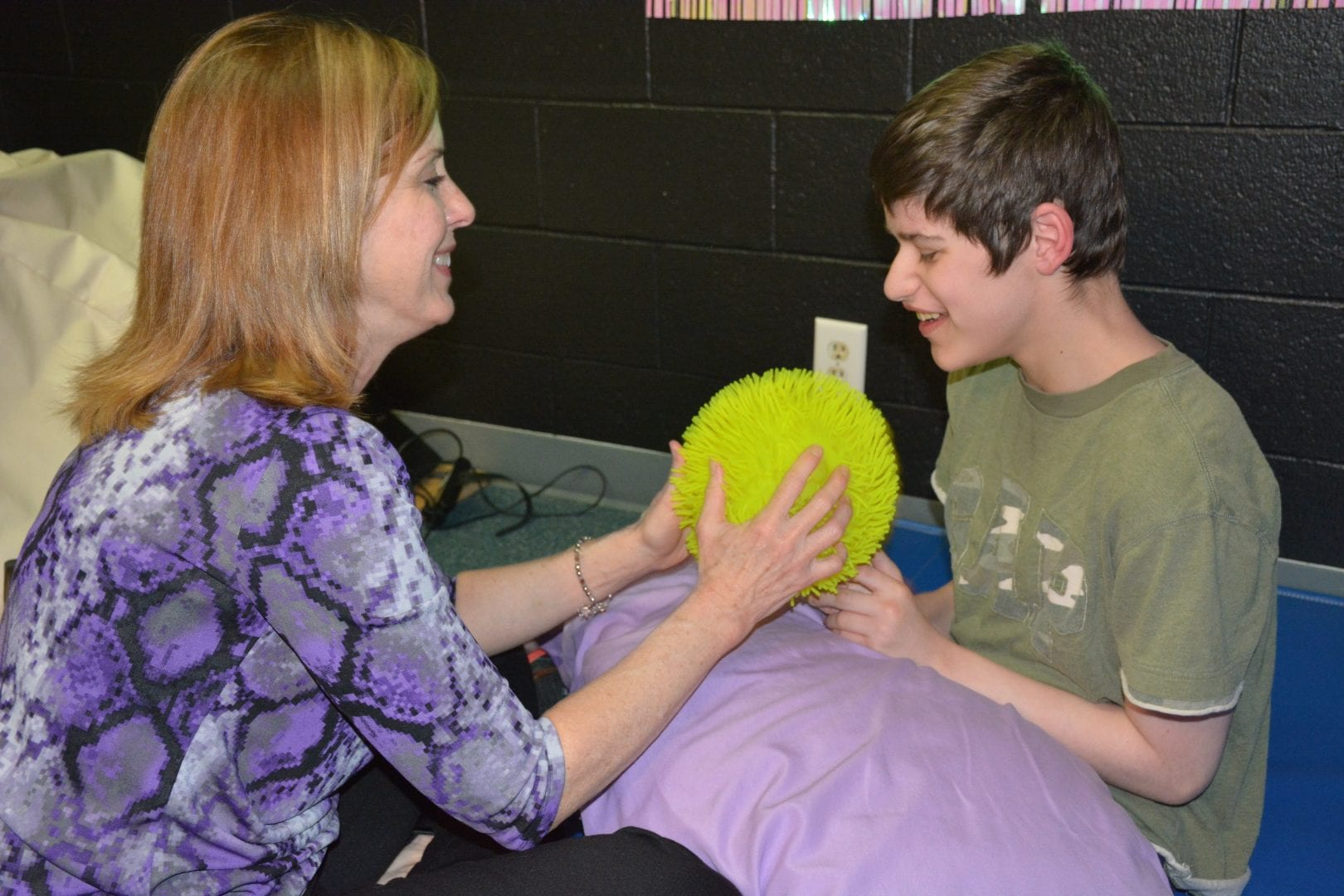 A learner begins to imitate his teacher during a Sensory Learning Kit play routine.
