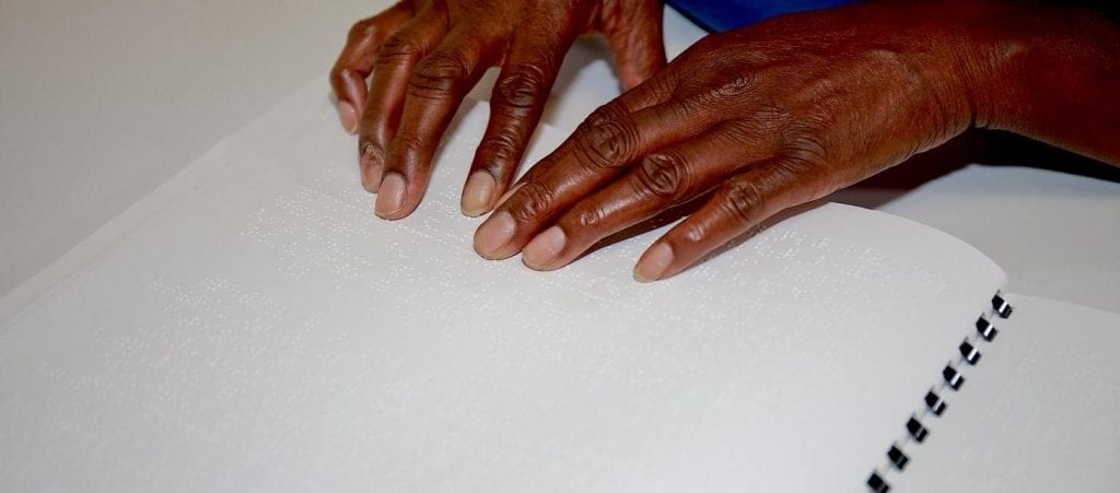 Student Hands Reading Braille Picture