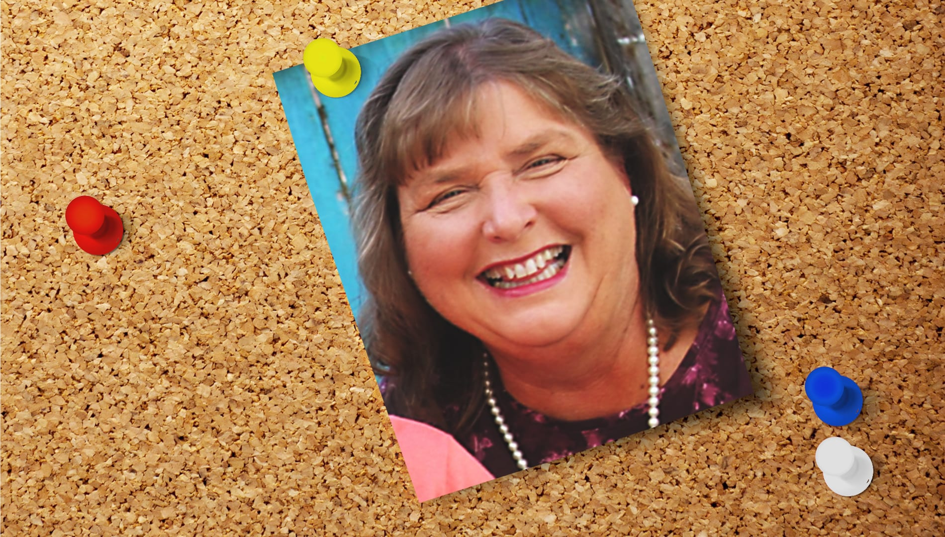 a photo of Barbara Peterson pinned to a cork board