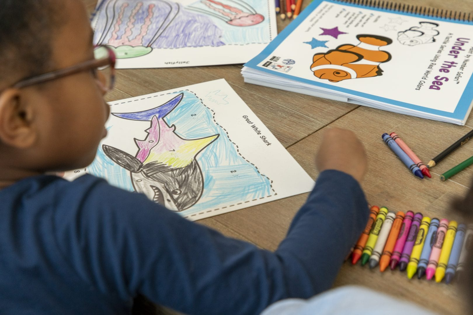 student coloring a Paint by Number Safari coloring page
