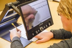 close up of a student using Jupiter to magnify their school work