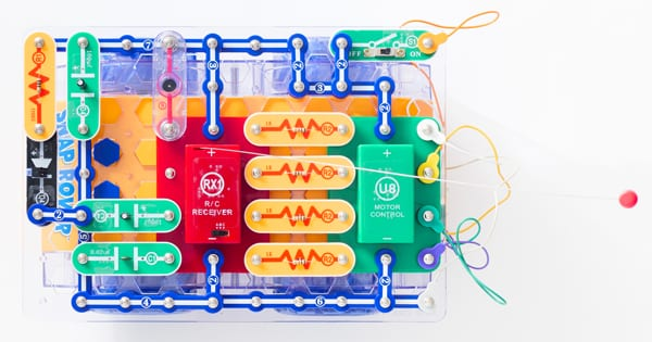 snap circuits pieces assembled including battery packs and wires, to build RC Snap Rover