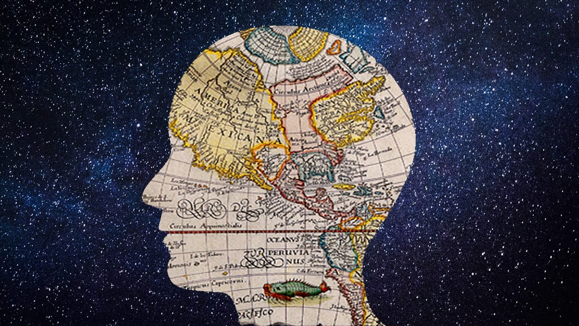 silhouette of a head in profile against a starry sky. the head if is made up of a vintage map map