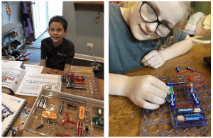 Side by side photos of students with snap circuits jr kits. Student on left is smiling with the kit and instructions spread out in front of them. Student on the right leans in closely to the snap circuits board as they read the braille on one of the pieces