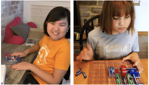 Side by side photos of students with snap circuits jr kits.student on the left smiles at the camera while pressing the button on the board that makes the propeller spin and light come on. student on the right assembles pieces at a kitchen table.
