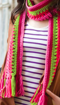 woman modeling a multicolored taffy pull crocheted scarf