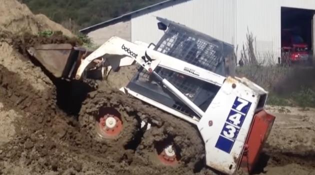 McLaren over-the-tire skid steer tracks