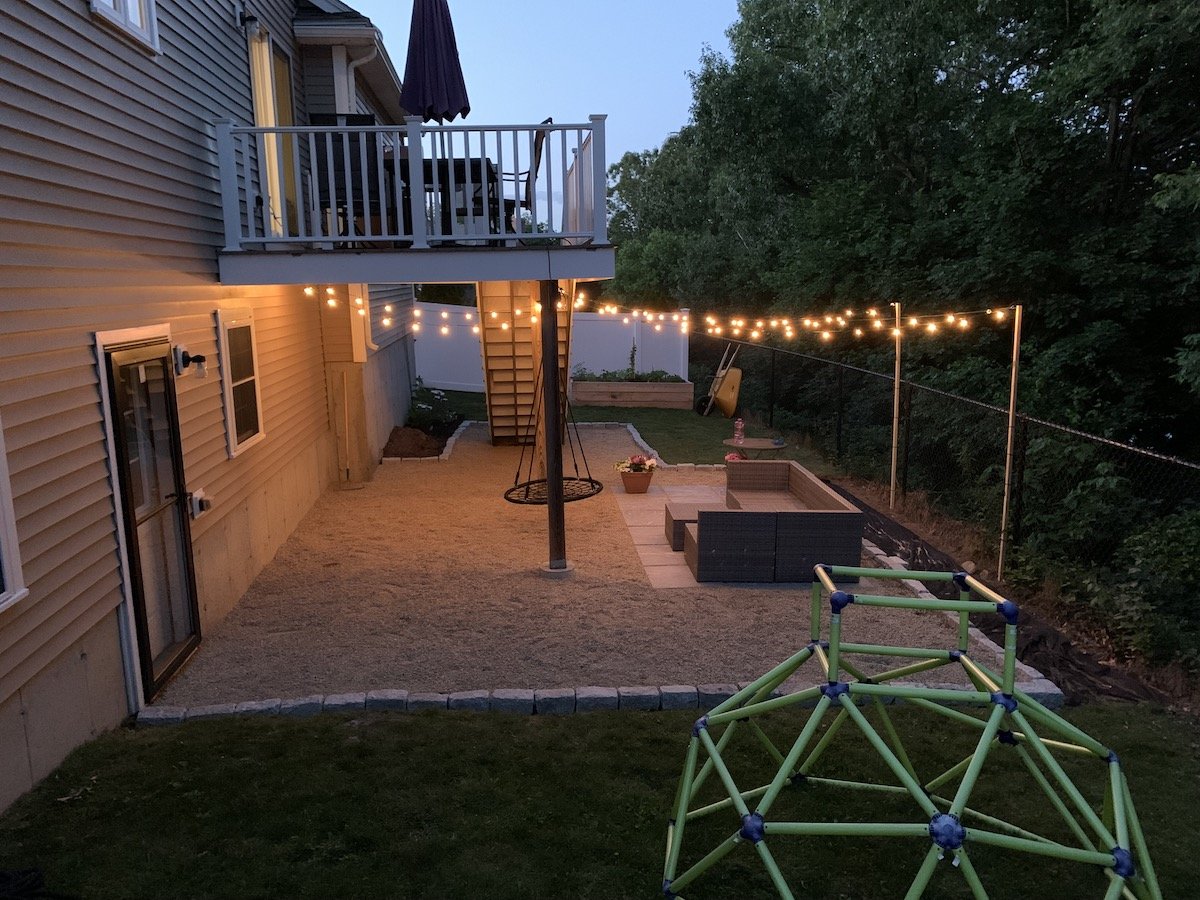 Full photo of the patio in our backyard at night.