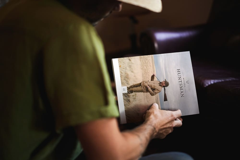 A man reading a hunting magazine