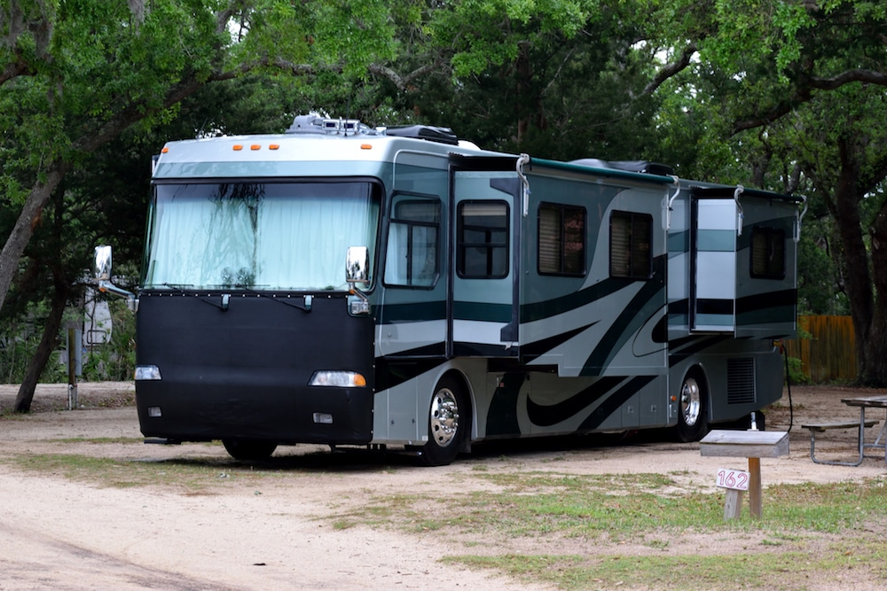 A Class A RV parked with slide outs extended.