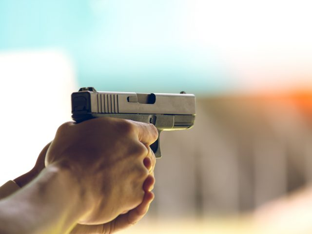 A handgun shown at a gun range