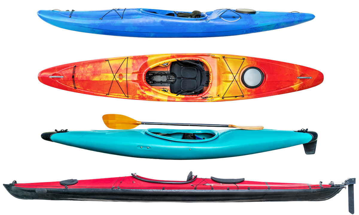 a collection of sea and whitewater kayaks isolated on white