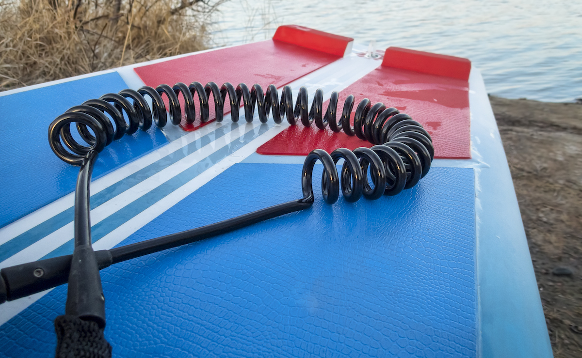 coil safety leash on paddleboard