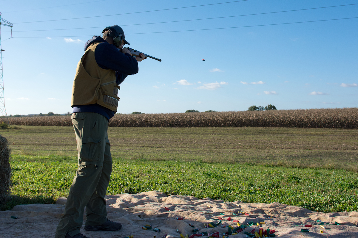 Man Shooting Shotgun in a field
