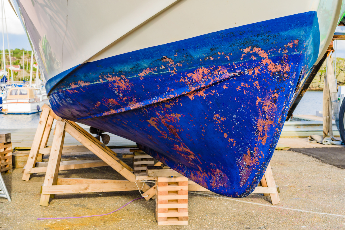 Close up of a blue boat keel seen from the front or fore.
