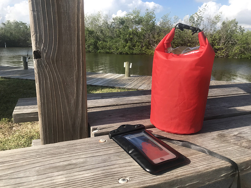Dry bag for paddle board fishing setup