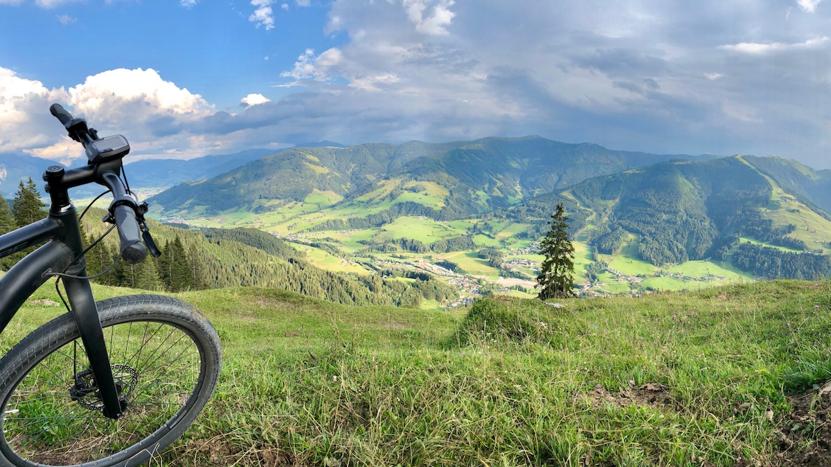 mountain bike front wheel and the view of some mountains