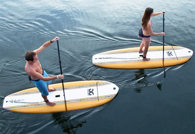 Couple using soft top paddleboards