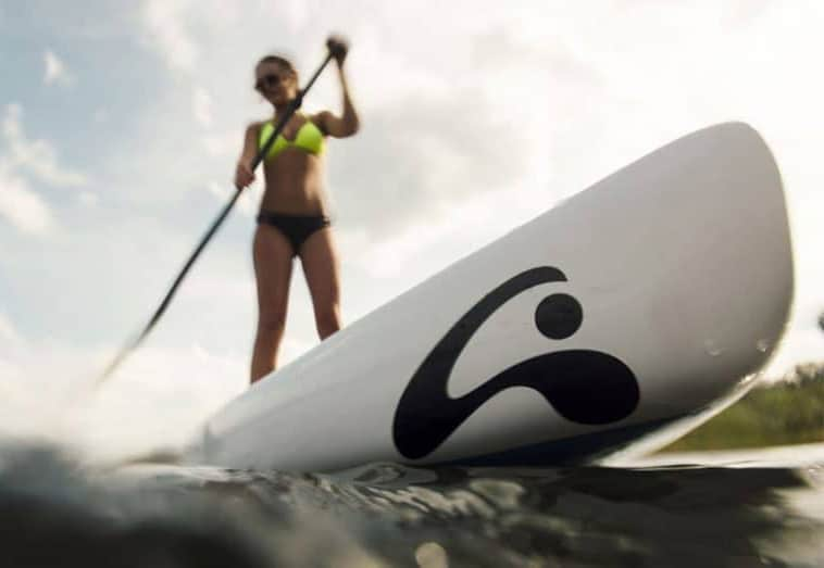 Woman standing on racing paddleboard