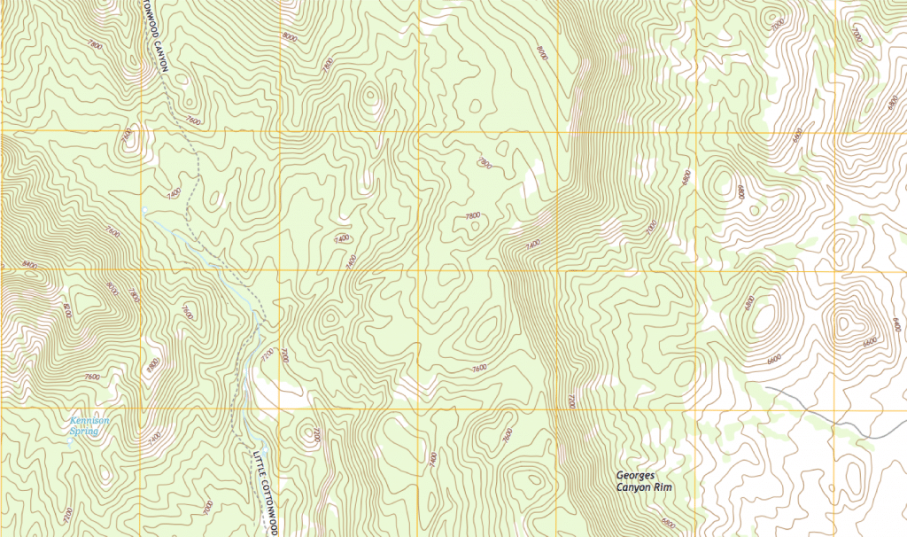 In this picture you can see both what peaks and cliffs look like on a topo map.