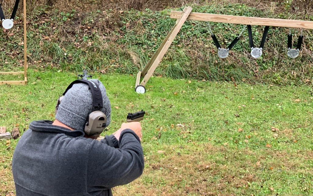 Man shooting at hanging steel targets