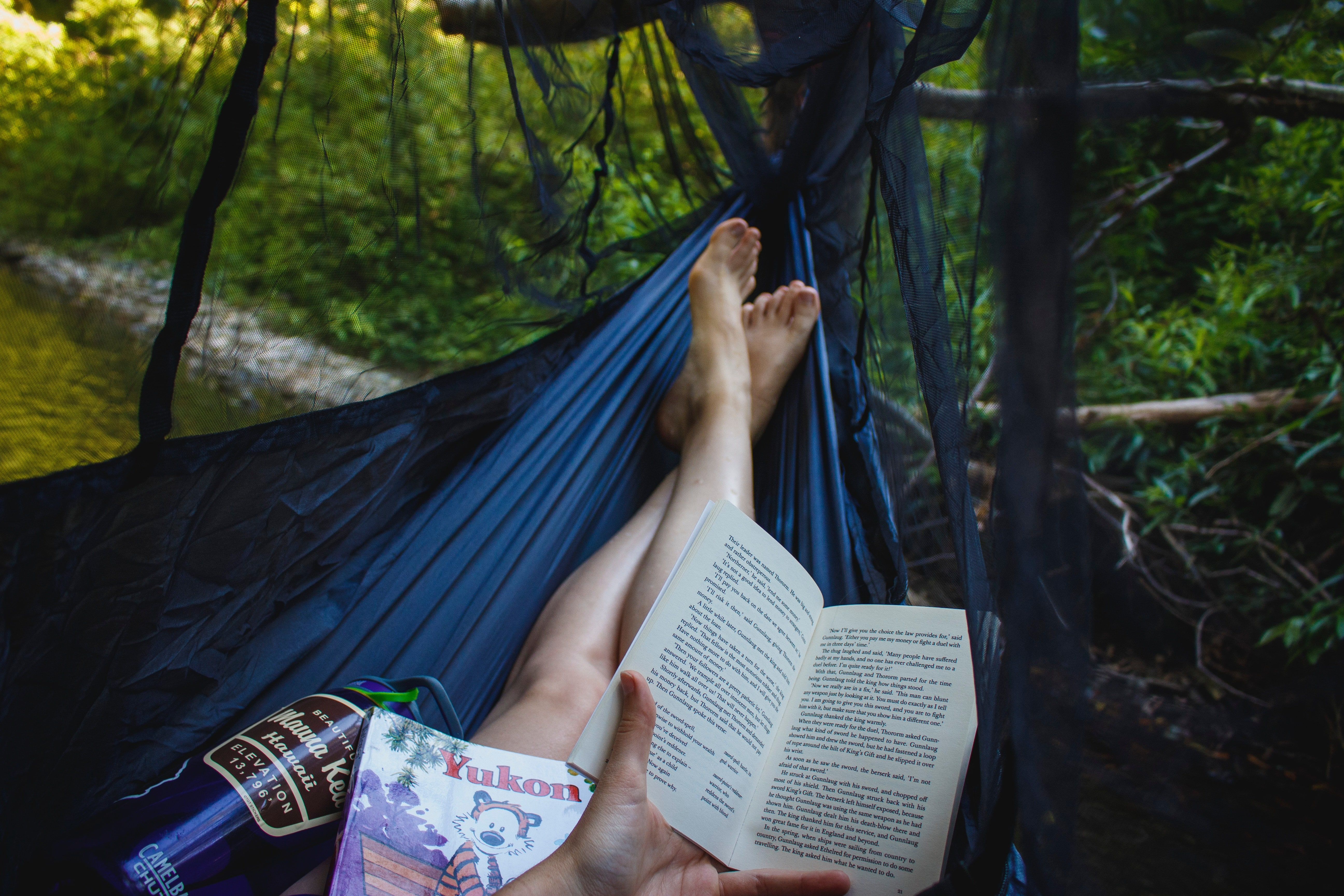 Hammock camping and reading a book