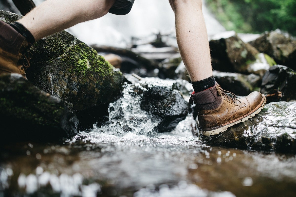 hiking boots getting wet in a stream